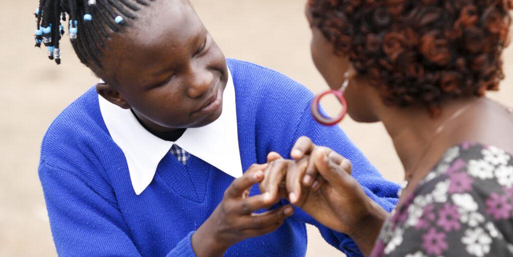 Schoolgirl with deafblindness communicating