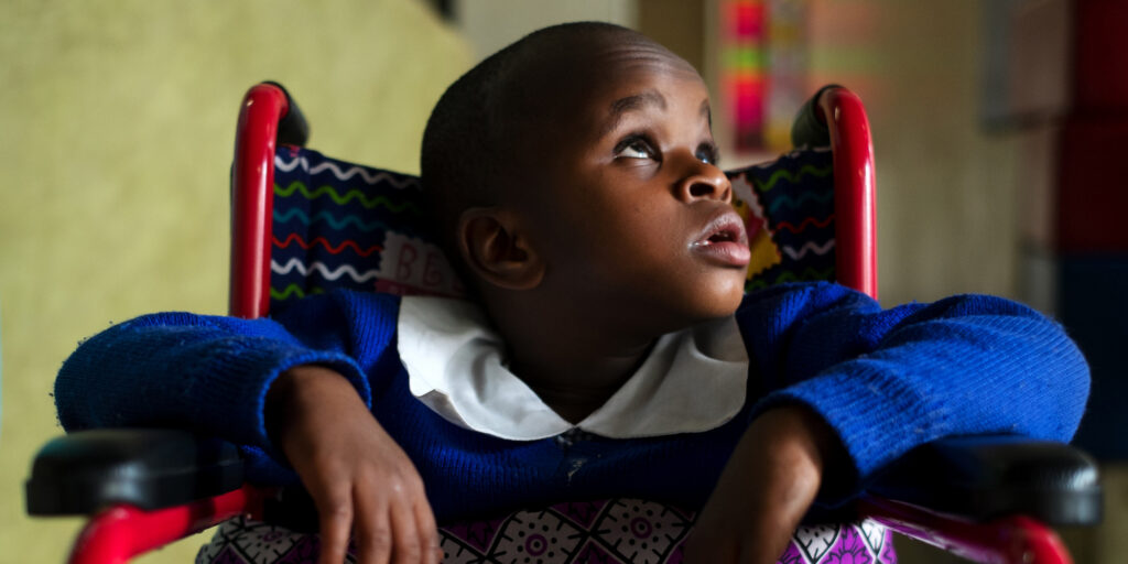 Child with deafblindness in a wheelchair