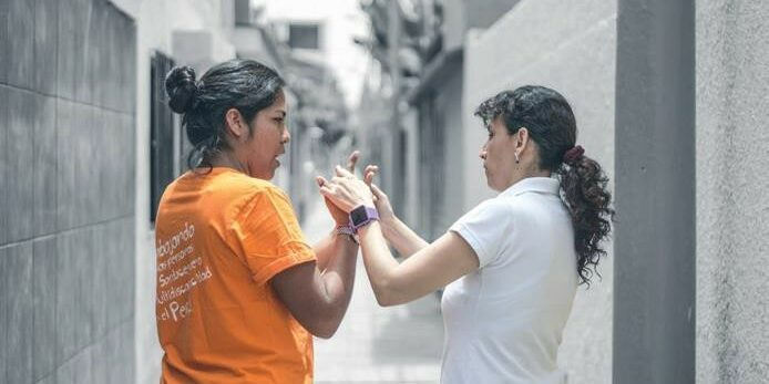 Social worker and woman with deafblindness