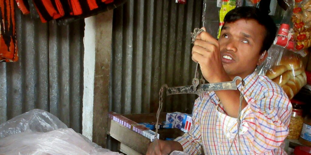Man with deafblindness at work