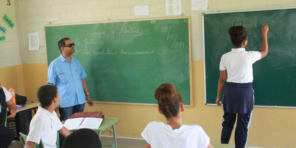 Teacher with deafblindness at school